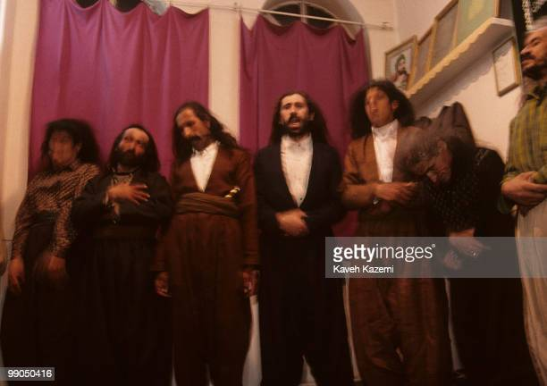Kasnazani dervishes flinging their long hair and chanting 'Allah Allah during remembrance ceremony held on a Thursday night in a mosque in Sanandaj...