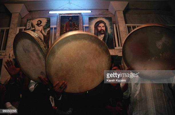 A remembrance ceremony of Kasnazani dervishes starts with slow beating of a tambourines and chanting the name of God Pictures of Imam Ali and Abdol...
