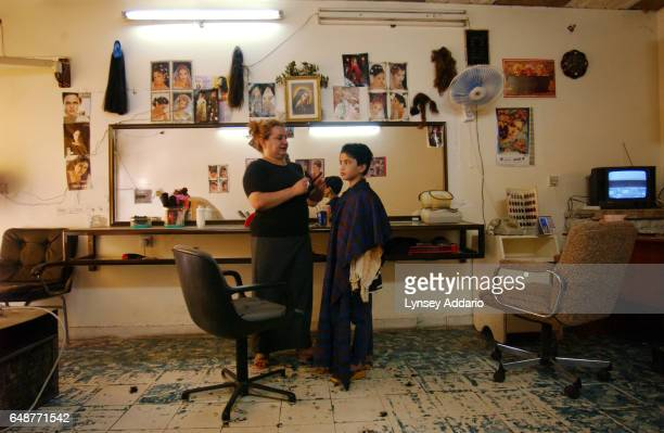 Sanaria gets a haircut in a salon in Baghdad Iraq August 2003 Sanaria was abducted and raped by several men from the stairwell in her former...