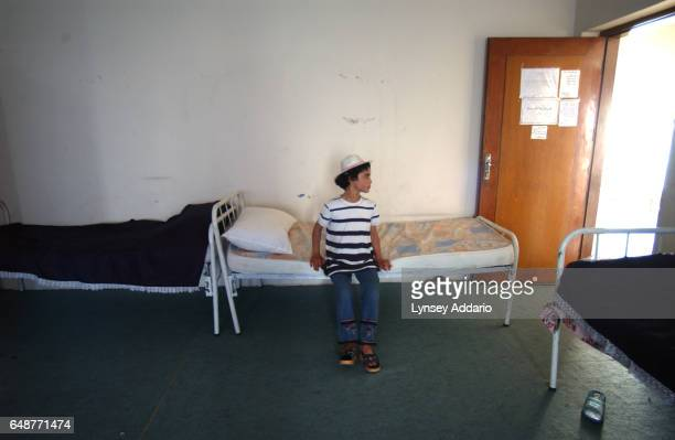 Sanaria sits on her new bed at the orphanage where she has been placed when removed from her family home in Baghdad Iraq August 2003 Sanaria was...