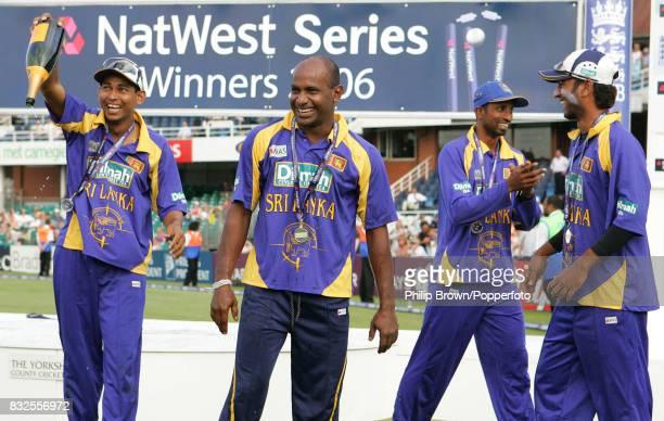 Sanath Jayasuriya of Sri Lanka celebrates with teammate Tillakaratne Dilshan and squad members Russel Arnold and Kaushal Lokuarachchi after Sri Lanka...