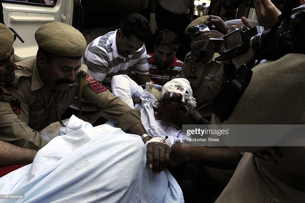 Sanaullah, an Pakistani prisoner of India's central Jammu jail at Kot Bhalwal carried on a stretcher to be shifted for treatment from Jammu hospital on May 3, 2013 , in Jammu, India. 54 year old Sanaullah ,a resident of Sialkot was attacked by fellow prisoners in Kot Bhalwal Jail. He was serving a life sentence for terrorist activities. He had been in the Kot Bhalwal Jail for the last 17 years. With the death of Sarabjit, there has been a mass outpouring of public outrage.
