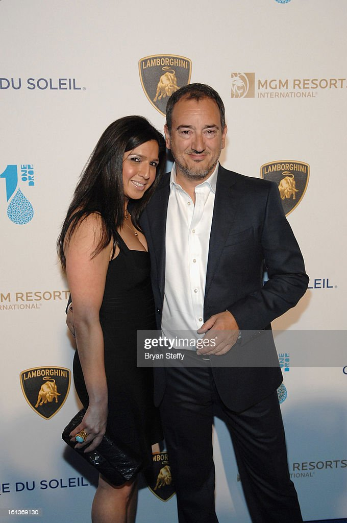 Sanaz Limouee (L) and Chief Executive Officer of Automobili Lamborghini America Michael Lock arrive at Cirque du Soleil's 'One Night for ONE DROP' at Hyde Bellagio at the Bellagio on March 22, 2013 in Las Vegas, Nevada.