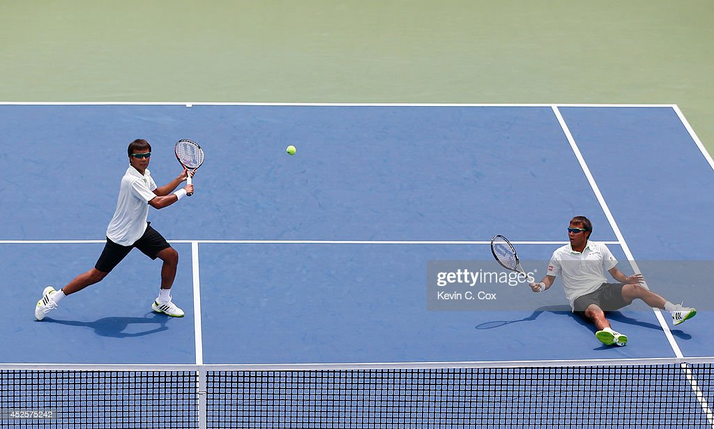 Sanchai and Sonchat Ratiwatana of Thailand play a point against Victor Estrella Burgos of the Dominican Republic and Nicolas Barrientos of Colombia during the BB&T Atlanta Open at Atlantic Station on July 23, 2014 in Atlanta, Georgia.