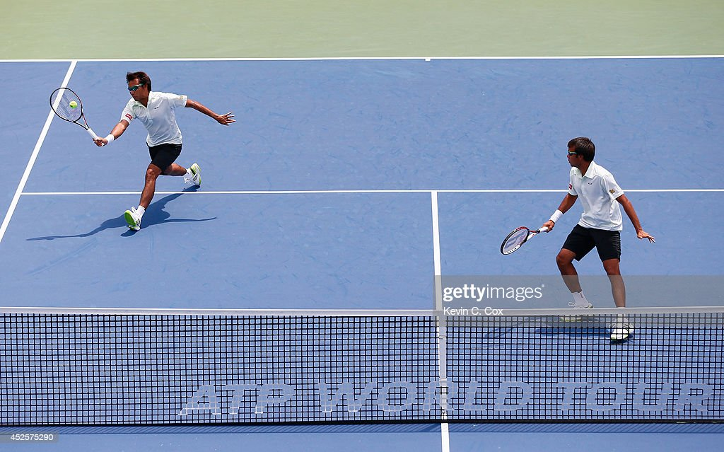 Sanchai and Sonchat Ratiwatana of Thailand return a shot to Victor Estrella Burgos of the Dominican Republic and Nicolas Barrientos of Colombia during the BB&T Atlanta Open at Atlantic Station on July 23, 2014 in Atlanta, Georgia.