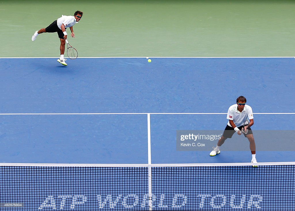 Sanchai and Sonchat Ratiwatana of Thailand serve to Victor Estrella Burgos of the Dominican Republic and Nicolas Barrientos of Colombia during the BB&T Atlanta Open at Atlantic Station on July 23, 2014 in Atlanta, Georgia.