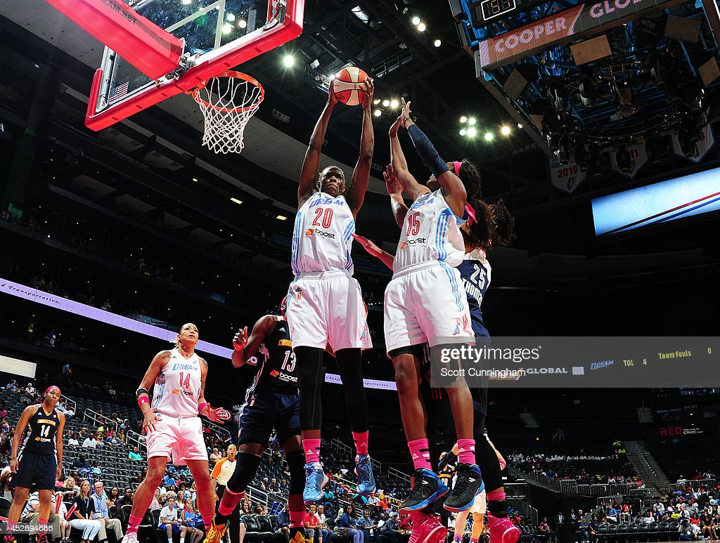 Sancho Lyttle #20 and Tiffany Hayes #15 of the Atlanta Dream go up for a rebound against the Connecticut Sun on July 29, 2014 at Philips Arena in Atlanta, Georgia.