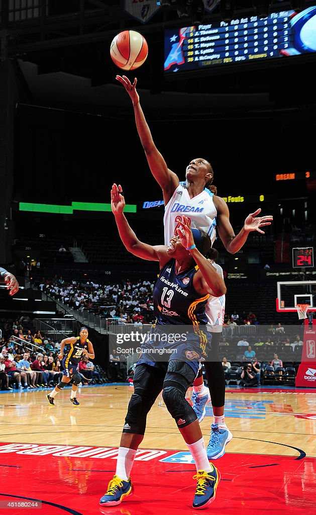 Sancho Lyttle #20 of the Atlanta Dream battles for a rebound against Karima Christmas #13 of the Indiana Fever on July 1, 2014 at Philips Arena in Atlanta, Georgia.