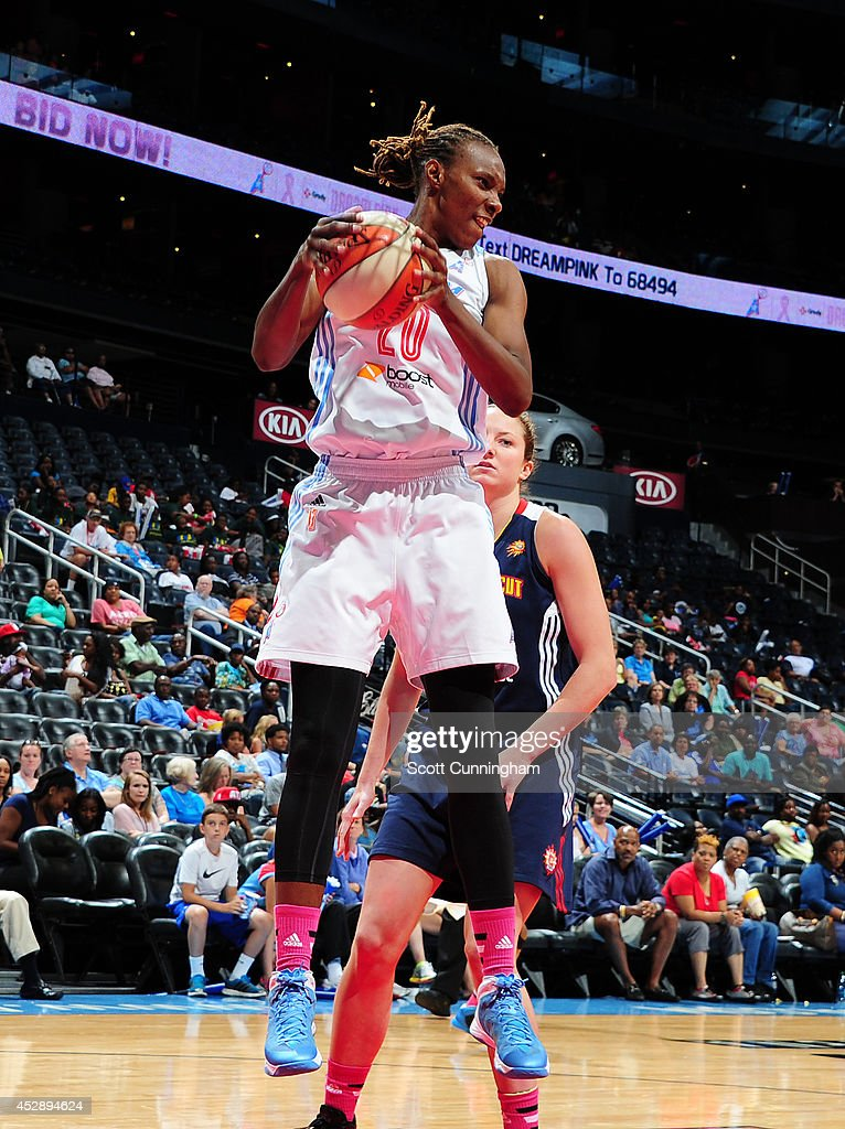 Sancho Lyttle #20 of the Atlanta Dream grabs a rebound against the Connecticut Sun on July 29, 2014 at Philips Arena in Atlanta, Georgia.