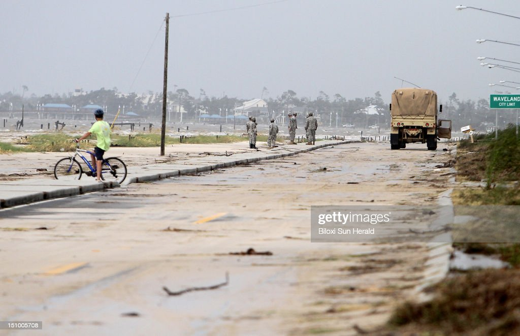 Sand and debris litters North Beach Boulevard while the US Army National Guard patrols in Waveland Mississippi on Thursday August 30 as Tropical...