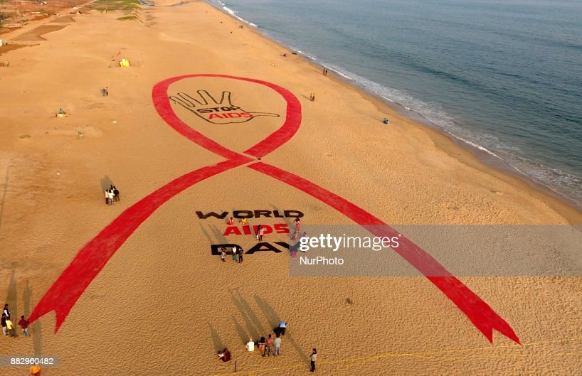 A sand art is seen at the Bay of Bengal Sea's eastern coast beach at Puri on the eve of World AIDs Day for public awareness as it is creating by Inernational aclaimed sand artist Sudarshan Pattnaik at Puri, 65 km away from the eastern Indian state Odisha's capital city Bhubaneswar on 30 November 2017.