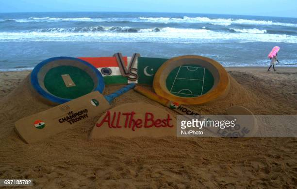 A sand art is seen in the Bay of Bengal's eastern coast beach as it created by Indian sand artist Sudarshan Pattnaik to encourage players of India...