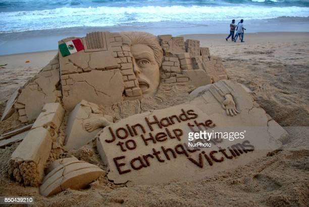 A sand art is seen on the Bay of Bengal Sea's eastern coast at Puri India on 21 September 2017 creating by sand artist Sudarshan Pattnaik for public...