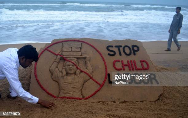 A sand art is seen on the Bay of Bengal Sea's eastern coast beach at Puri as it creating by International sand artist Sudarshan Pattnaik for public...
