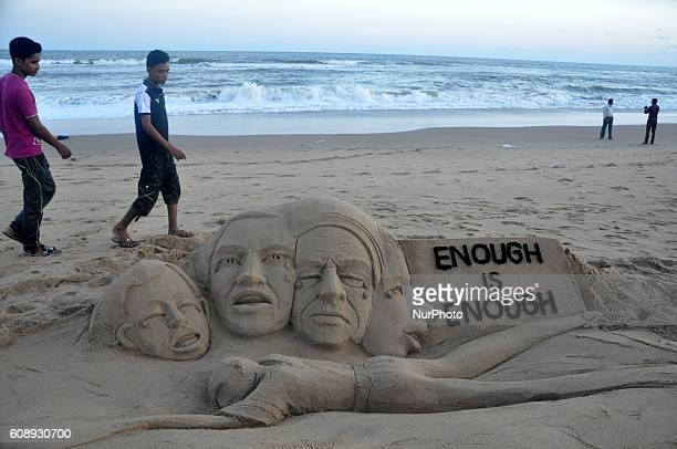 Sand artist Manas Sahoo creates a sand sculpture at the Bay of Bengal Seas eastern coast beach Puri on 20 September 2016 to spread message to stop...