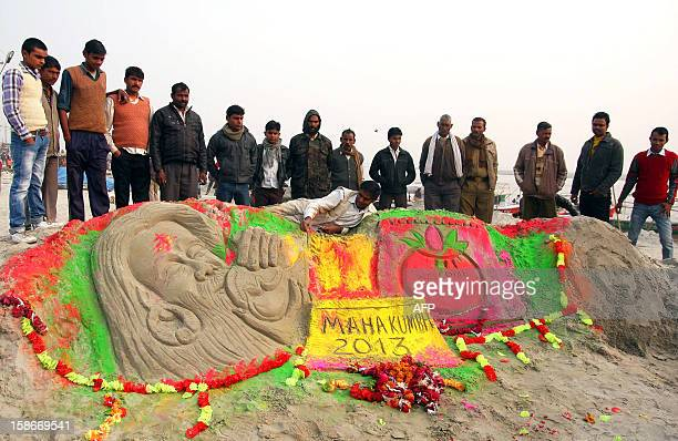 Sand artist Raj Kapoor creates a sand sculpture at the Sangam for welcoming tourists from all over the world through his sculpture in the upcoming...