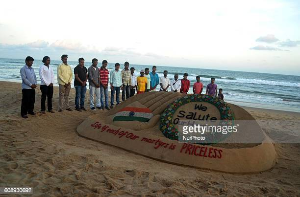 Sand artist Sudarshan Pattnaik gives the finishing touches to his sand sculpture at the Bay of Bengal Seas eastern coast beach Puri on 20 September...