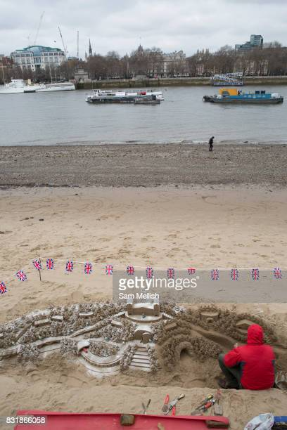 A sand artists creates a unique Smurf themed winter wonderland sand sculpture during low tide the Thames Beach on 19th February 2017 London United...
