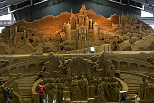 Sand artists work on sand sculptures ahead of 'Germany and Once Upon a Time' exhibition at the Sand Museum on April 6 2015 in Tottori Japan The sand...