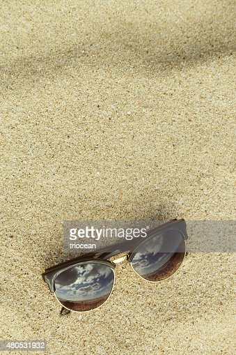 Sand background with sunglasses at the beach : Stock Photo