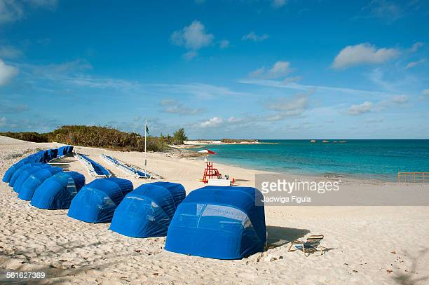 Sand beach of great stirrup cay with canopies.