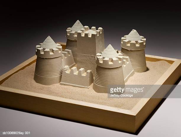 Sand castle in sand box, studio shot