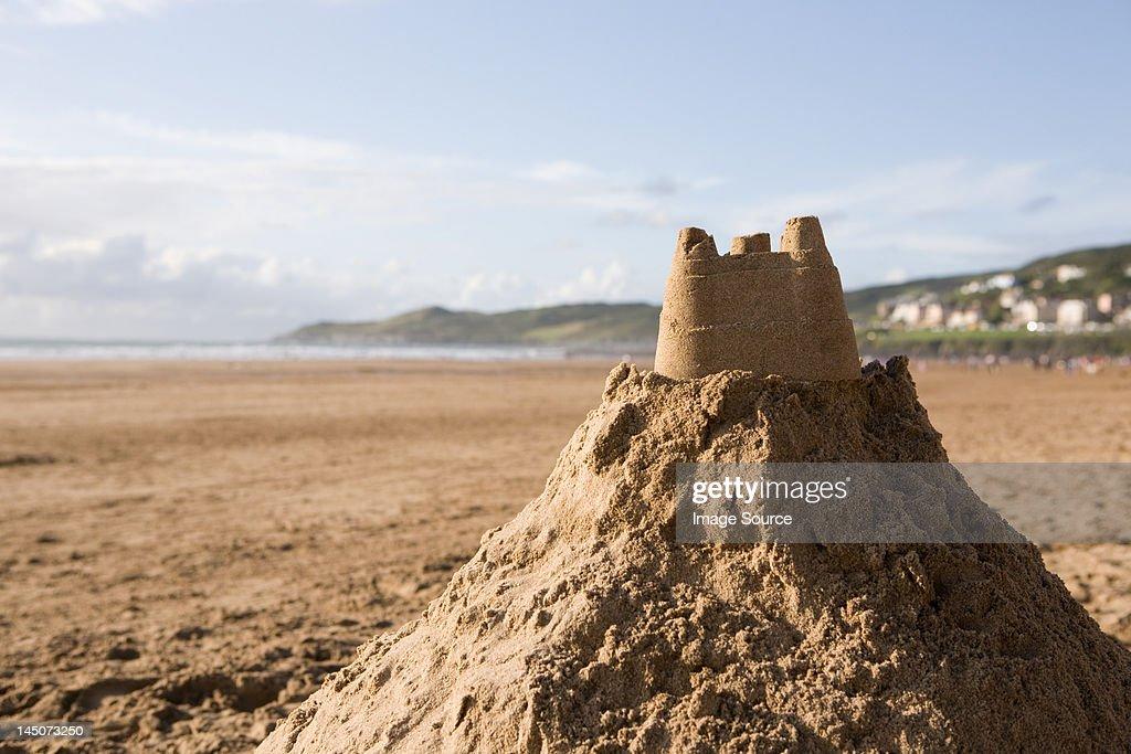 Sand castle on a beach : Stock Photo