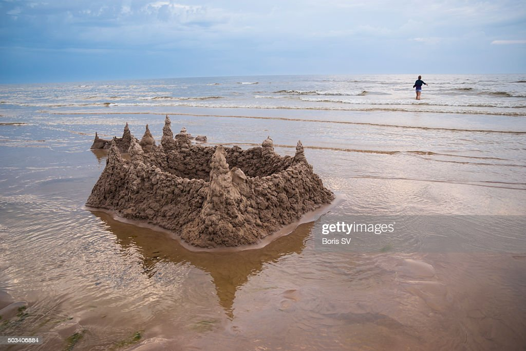 Sand castle surrounded by rising water. Jurmala, Latvia