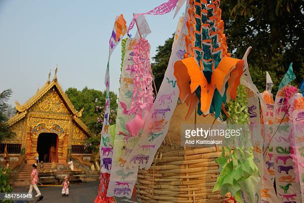 A sand chedi is decorated by colorful flags at Wat Chaimongkol during the Songkran festival The Songkran festival which is the traditional Thai new...