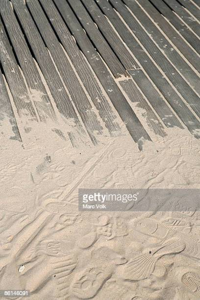 Sand covering wooden decking