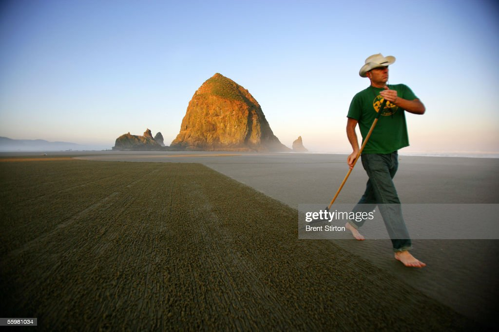 Sand drawing artist and avant-garde chef Jim Denevan works on an early morning drawing August 5, 2005 in Canon Beach, Oregon. The 'Outstanding In The Field,' team, under the leadership of artist/chef Jim Denevan, hosts organic farm dinners in esoteric locations across America and into Canada.