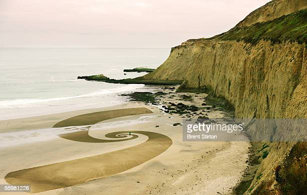 A sand drawing by artist and avantgarde chef Jim Denevan is shown August 5 2005 in Canon Beach Oregon The 'Outstanding In The Field' team under the...
