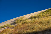 sand dune landscape by summer evening with clear blue sky