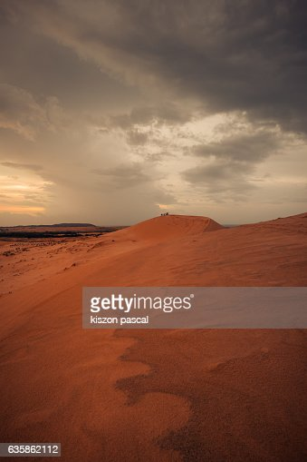 Sand dune with beautiful dramatic sky in the morning , Vietnam
