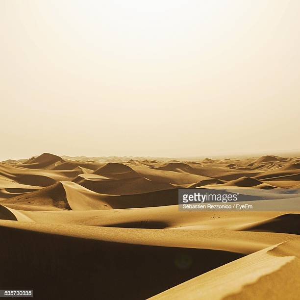 Sand Dunes Against Clear Sky