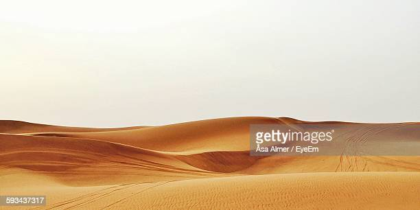Sand Dunes In The Desert Against Clear Sky