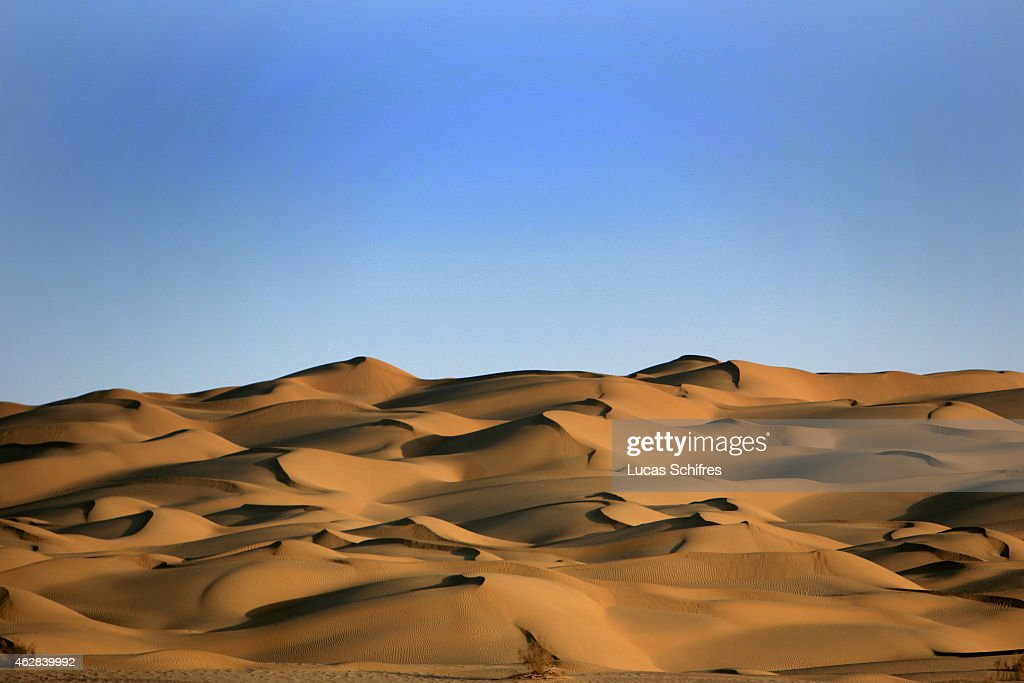 Sand dunes in the Taklamakan desert on October 12 2006 in Xinjiang province China The Taklamakan Desert is a desert in Central Asia in the Xinjiang...