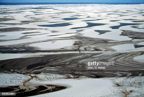 Sand dunes known as white sheets and freshwater lakes Lencois Maranhenses national park Maranhao state Brazil