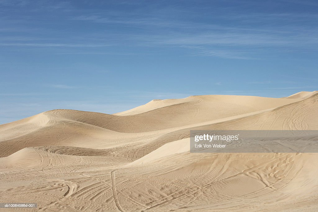 Sand dunes with track marks : Stock Photo