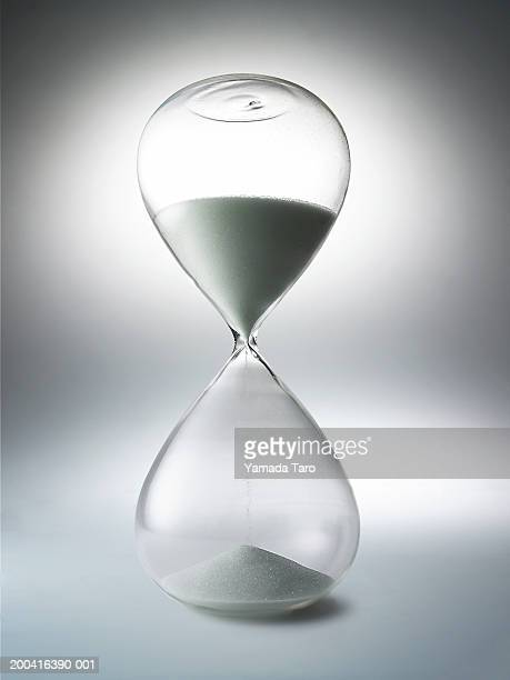 Sand falling through hourglass, close-up