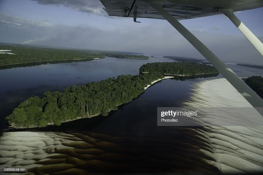 Sand formations on river's bed in forest, aerial view : Stock Photo