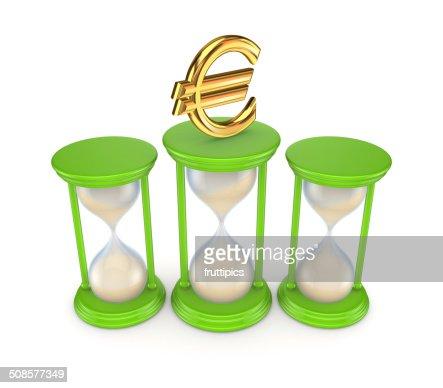 Sand glasses and euro symbol. : Stock Photo