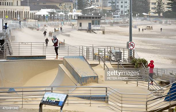 Sand is blown by strong winds off of Bondi Beach over a skate park at Sydney's most famous beach on April 21 2015 Sydney and surrounding areas were...