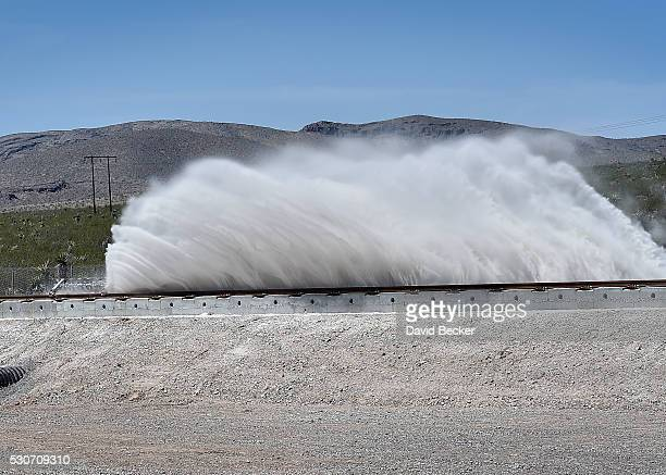 Sand is displaced as a test sled is slowed during the first test of the propulsion system at the Hyperloop One Test and Safety site on May 11 2016 in...