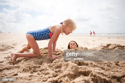 Sand mermaid making is hard work! : Stock Photo