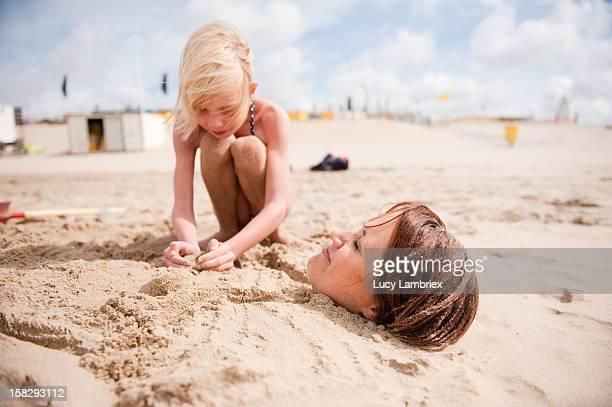 Sand mermaid making: shaping boobies