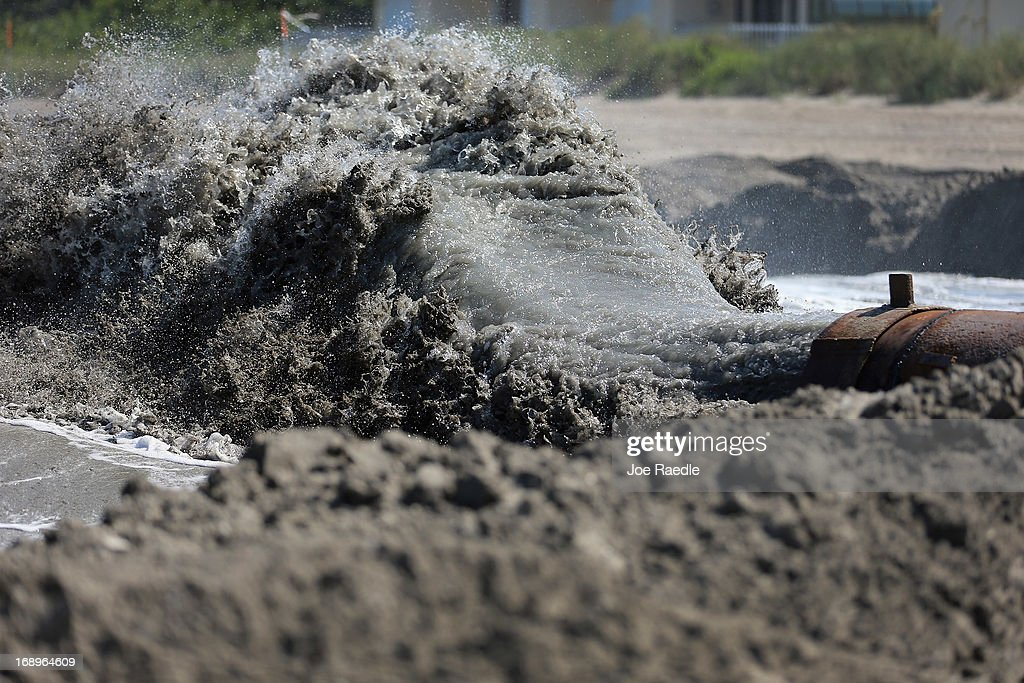 Sand mixed with seawater pours from a discharge pipe during a federally funded shore protection project by Great Lakes Dredge and Dock on May 17, 2013 in Fort Pierce, Florida. As cities along the East Coast prepare for the start of the hurricane season, officials say the area encompasing Fort Pierce beach has been in dire need of repair since Hurricane Sandy last year made worse an area already suffering significantly from erosion. Some experts say shore restoration projects can help reduce the physical and economic damage from waves, storm surge, and the resulting coastal flooding in a hurricane.