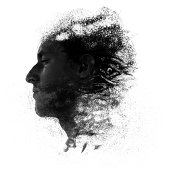 Conceptual creative image of a man profile portrait man made of sand, fading away blown out by the wind
