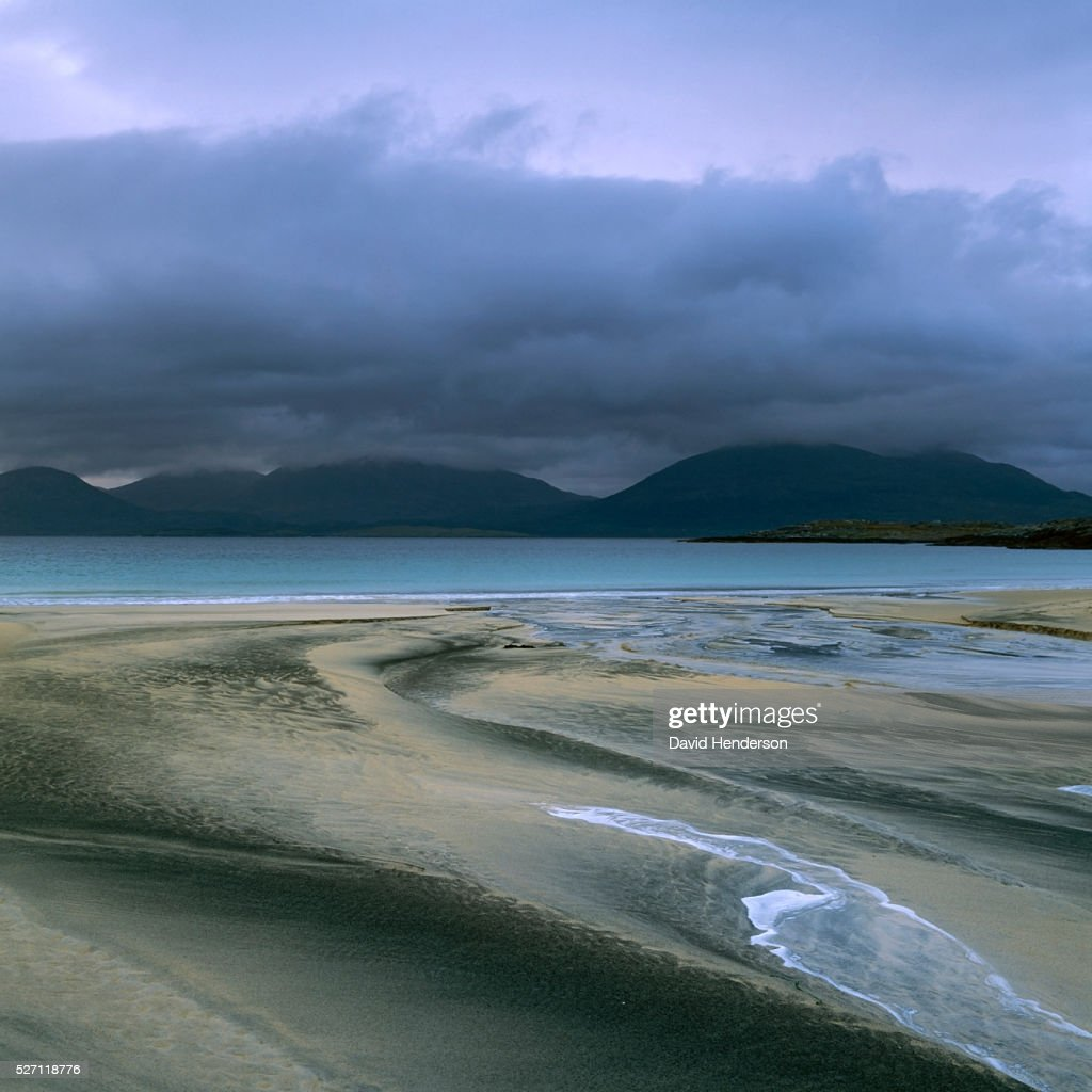 Sand patterns and view across to Taransay : Stock-Foto