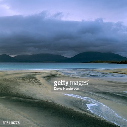 Sand patterns and view across to Taransay : Stock Photo